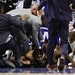 Minnesota Timberwolves' Karl-Anthony Towns lies on the court after an altercation with Philadelphia 76ers' Joel Embiid during the second half of an NB