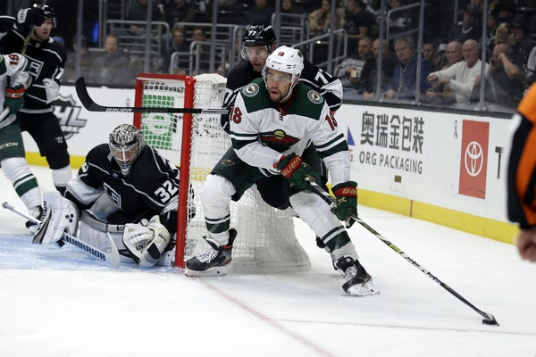 Jordan Greenway of the Wild skated around the Kings net on Tuesday night.