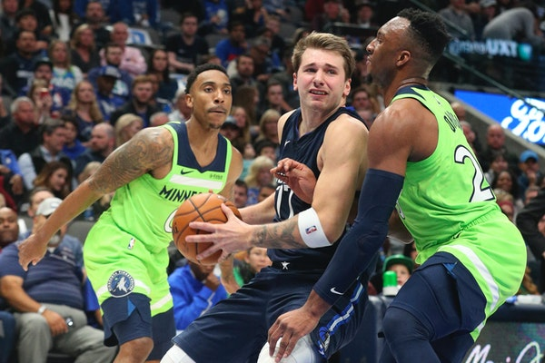 Dallas forward Luka Doncic tried to get past Timberwolves guard Josh Okogie for a shot in the second quarter.