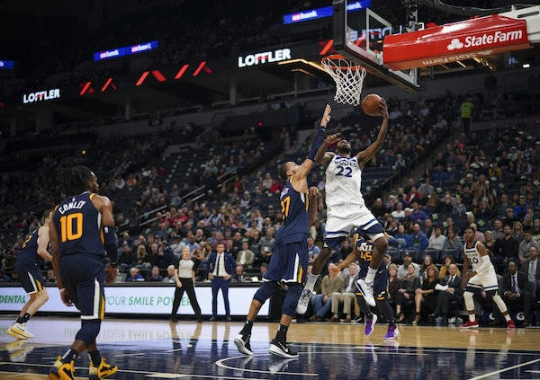 Andrew Wiggins (22) scoring two of his team high 22 points in the fourth quarter.