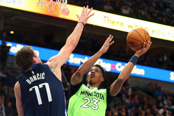 Dallas forward Luka Doncic tries to defend against a shot by Timberwolves guard Jarrett Culver on Wednesday.