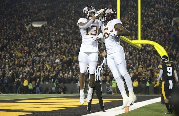 Gophers wide receivers Rashod Bateman (13) and Tyler Johnson celebrated Johnson's third-quarter touchdown reception on Saturday.
