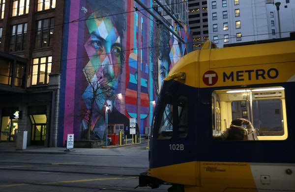 A light rail train heads south from the Target Field station in downtown Minneapolis.
