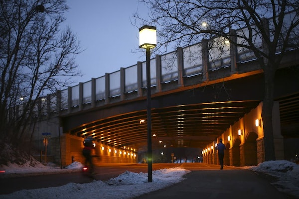 A jogger followed Minnehaha Parkway under the Interstate 35W overpass. Neighbors have raised concerns about plans about proposed changes to the parkwa