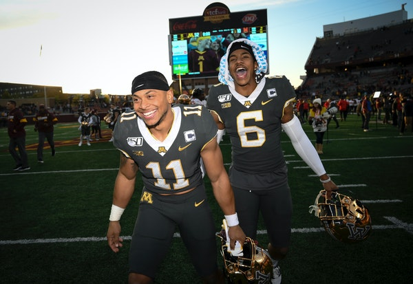 Gophers defensive backs Antoine Winfield Jr. (11) and Chris Williamson were jubilant following their 52-10 victory over Maryland.