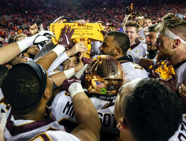 Gophers players celebrated with the Paul Bunyan Axe after beating Wisconsin 37-15 last season in Madison.
