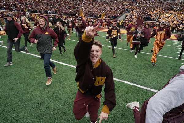 Giddy Gophers fans rush field after big win, kicking off wild celebrations
