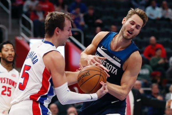 Detroit Pistons guard Luke Kennard (5) takes the ball away from Minnesota Timberwolves forward Jake Layman during the second half