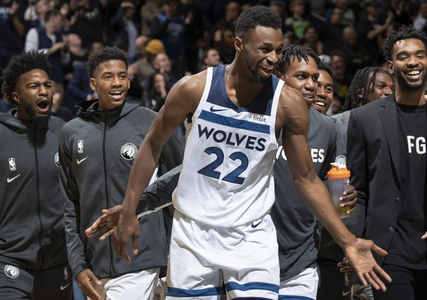 The Timberwolves' Andrew Wiggins was greeted by teammates after making his third three-pointer late in the fourth quarter against the Heat on Oct. 27.