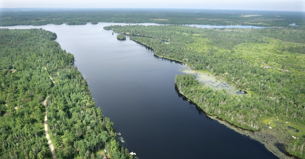 Twin Metals land looking down Birch Lake: Aerial view of Birch Lake showing the land that would become an underground mine (left) and additional land