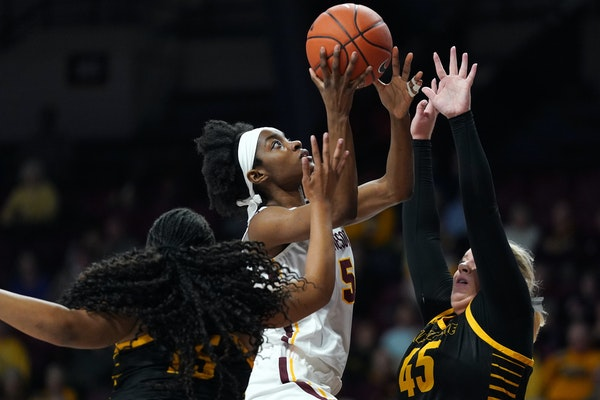 Minnesota Golden Gophers forward Taiye Bello (5) went up for a shot as Milwaukee Panthers forward Lizzie Odegard (45) defended in the first half.
