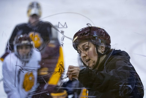 UMD women's hockey head coach Maura Crowell drew up some plays for her team at a recent practice.