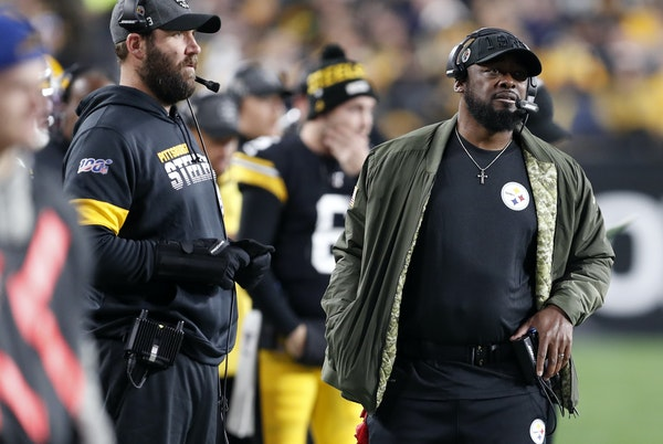 Steelers coach Mike Tomlin, right, even with quarteback Ben Roethlisberger on the sideline with him this season, still has Pittsburgh in contention fo