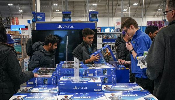 Shoppers looked for deals on PS4 and Xbox at the Richfield Best Buy store just after it opened at 5 p.m. Thursday. Nov. 28.