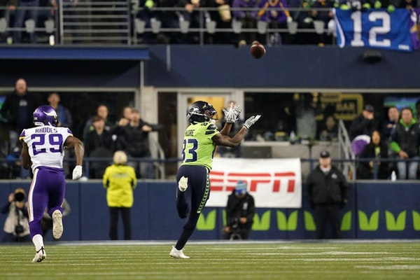 Seattle's David Moore raced past Vikings cornerback Xavier Rhodes for a 60-yard touchdown catch Monday night.