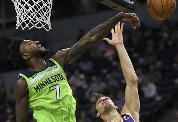 Jordan Bell swatted away a shot by former Timberwolf Dario Saric, one of his two blocks Saturday against Phoenix. Bell also had three points and nine