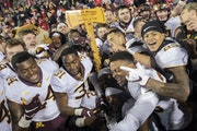 The Gophers celebrated with Paul Bunyan's Axe after beating Wisconsin at Camp Randall Stadium in 2018.