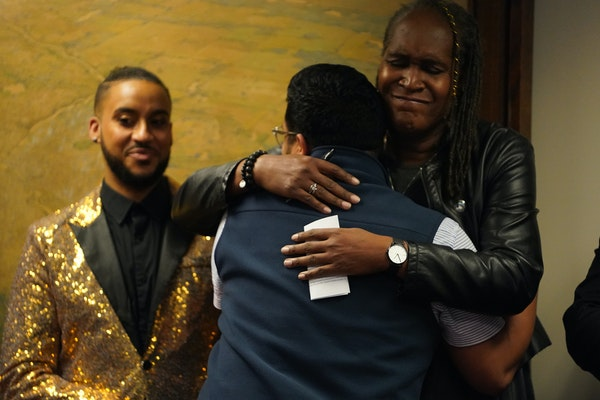 Council Member Phillipe Cunningham, who says he survived conversion therapy stood by as Roger Sanchez, a survivor of conversion therapy hugged Council