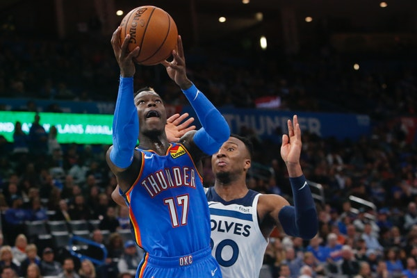 Oklahoma City guard Dennis Schroder shoots in front of Timberwolves guard Josh Okogie