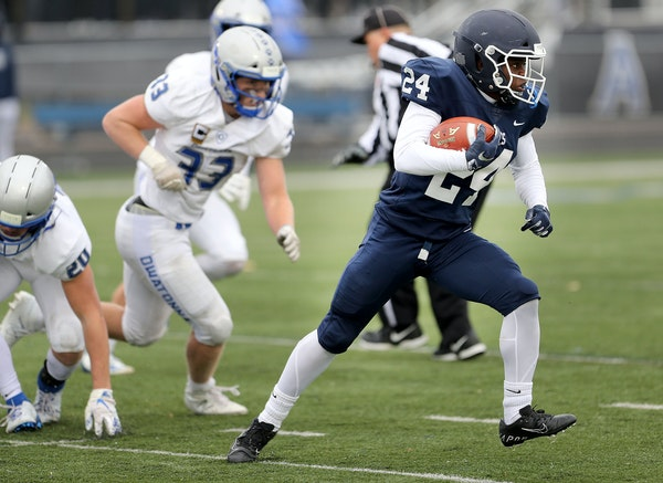 St. Thomas Academy running back Love Adebayo (24) is one of the keys to the Cadets' offense in the Class 5A game against high-scoring Elk River. Pho