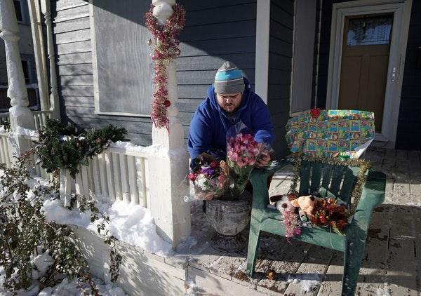 Neighbor Eric Stiver put flowers and stuffed animals on a chair on the porch of the home where David Schladetzky shot and killed Kjersten Schladetzky