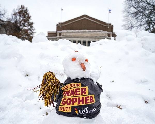 """A fresh snowman sat on Northrop Mall as nearby crews assembled the stage Wednesday afternoon in preparation for ESPN's """"College GameDay."""""""