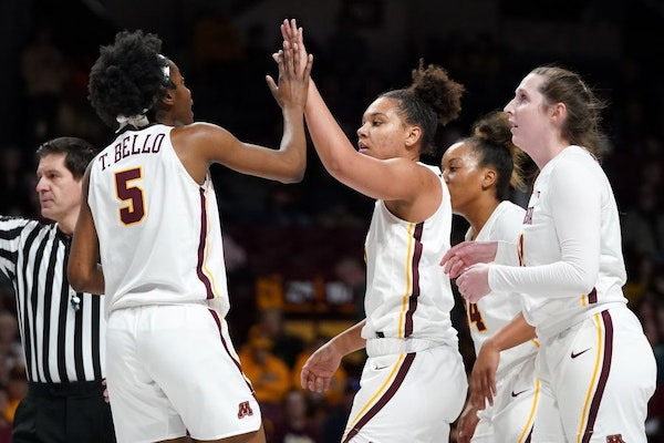 Gophers forward Taiye Bello gave a high five to guard Destiny Pitts during a game last month at Williams Arena. The Gophers won on the road Sunday.