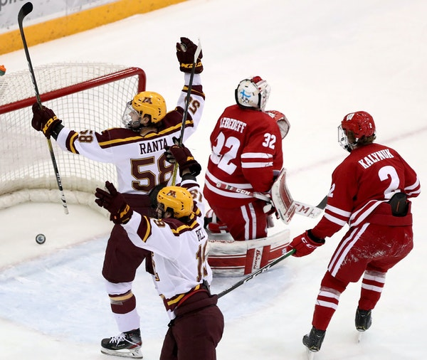 The Gophers' Scott Reedy (19) scores past Wisconsin's goalie Daniel Lebedeff during the first period.