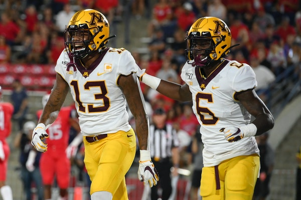 Gophers wide receivers Rashod Bateman (13) and Tyler Johnson (6) celebrated after a touchdown by Bateman on the opening drive vs. Fresno State earlier