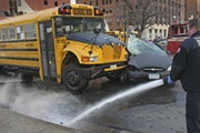 Minneapolis fire, police and Hennepin County paramedics responded to a First Student school bus/car crash in 2007.