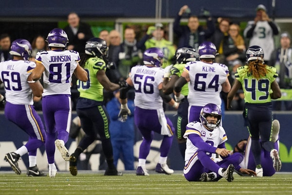 Vikings quarterback Kirk Cousins (8) sat on the field after a fumble in the third quarter.