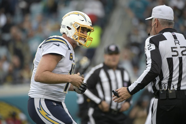 Chargers quarterback Philip Rivers talked with referee Bill Vinovich during Sunday's game in Jacksonville.