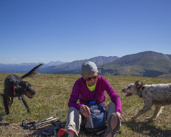 """Karen Neal of Grand Marais stays active —""""If I stop, I die,"""" she said. She is shown above with her dogs, Elke and Pippa, hiking Hoosier Pass in"""