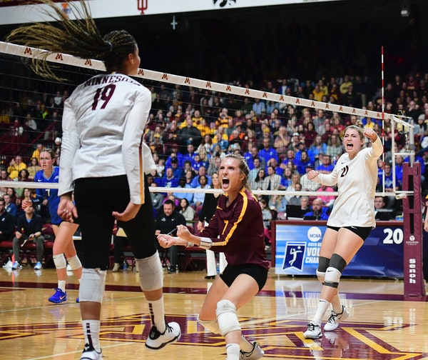 From left, Gophers outside hitter Alexis Hart (19), libero CC McGraw (7) and middle blocker Regan Pittman (21) celebrated a third set kill by Hart aga