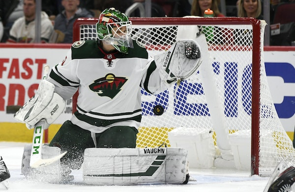 Wild goalie Kaapo Kahkonen was fooled on a deflection by the Blackhawks' David Kampf during the second period Sunday.