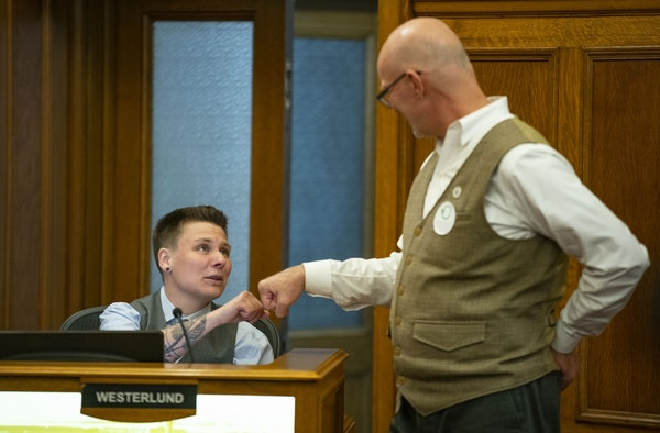 Duluth City Council Members Em Westerlund, left, and Gary Anderson fist bumped before their session on Monday where the council approved a ban on conv