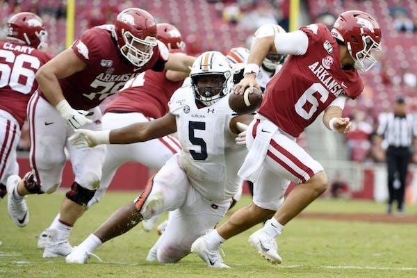 Auburn defensive tackle Derrick Brown (5) pressures Arkansas quarterback Ben Hicks earlier this season. He is among the top defensive players in the n