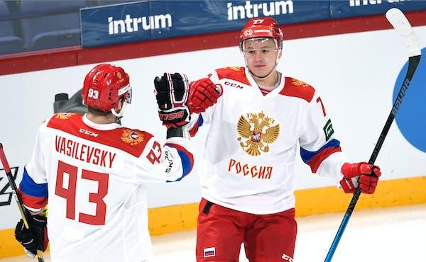 Russia's Alexei Vasilevsky, left and Kirill Kaprizov celebrate Kaprizov's opening goal during the Hockey Euro Hockey Tour Karjala Cup match between Cz