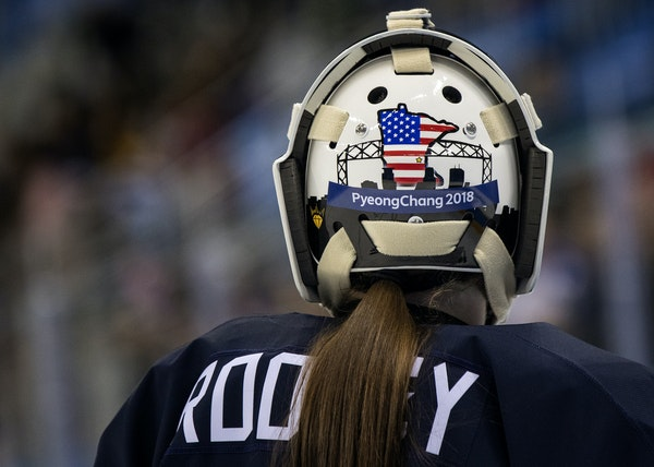 The Minnesota and Duluth themed mask of USA goalie Maddie Rooney (35).