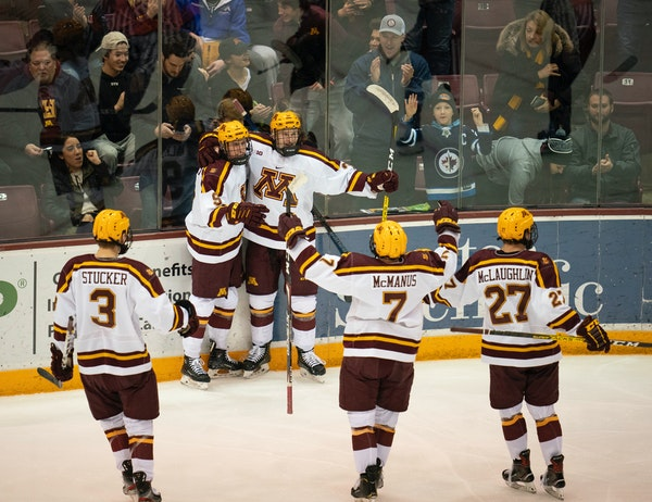 Minnesota's Sammy Walker, left, celebrated his second period goal, the first of the game, with teammate Ben Meyers (39)