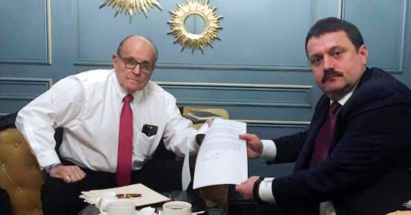 Rudy Giuliani meets with Ukrainian lawmaker Adriii Derkach in Kyiv, Ukraine, Thursday, Dec. 5, 2019.