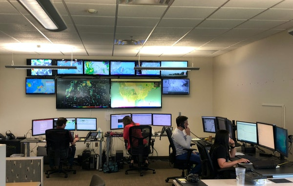 DTN meteorologists do forecast work at an office in Norman, Okla.