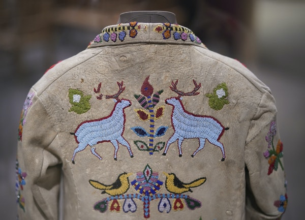 """A child's floral jacket made by a Dakota artist in the late 1800s is on display at """"Our Home: Native Minnesota."""""""