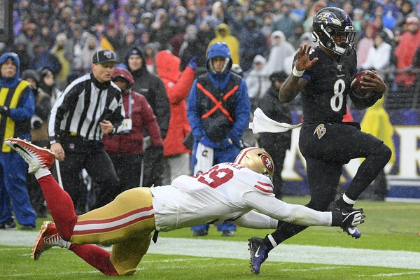 Baltimore quarterback Lamar Jackson was forced out of bounds by 49ers tackle DeForest Buckner on Sunday during the Ravens' victory.