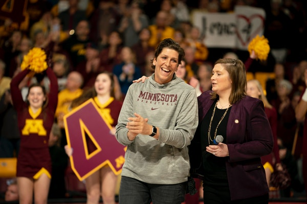 Janel McCarville stood with Gophers coach and former teammate Lindsay Whalen during Sunday's jersey retirement ceremony