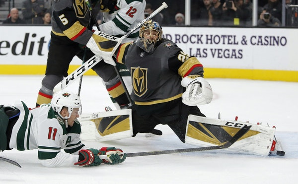 Golden Knights goaltender Marc-Andre Fleury blocked a shot by Wild left winger Zach Parise during the first period Tuesday. Parise scored in the final