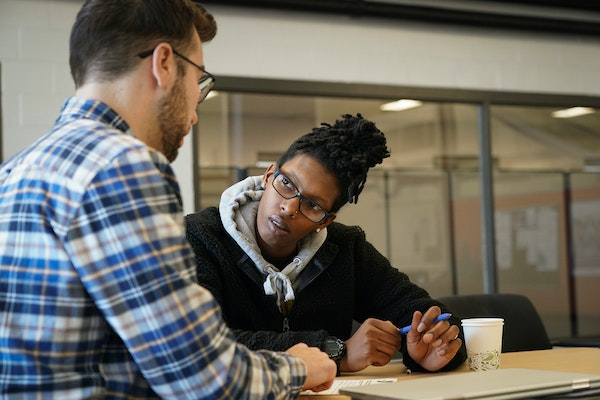 YMCA worker Alex Giesen, left, and Satoria Moran, 24, met at the New Hope YMCA to catch up and fill out paperwork for membership to the club, one of t