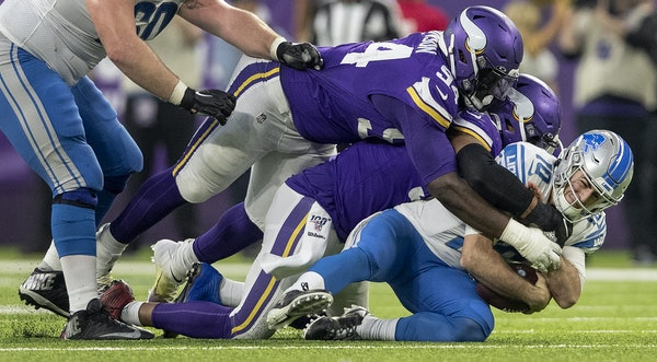 Everson Griffen (97) of the Vikings sacked Lions quarterback David Blough (10) in the fourth quarter Sunday while Jaleel Johnson (94) piled on.