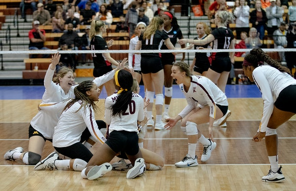 Gophers volleyball players celebrated their sweep of Louisville on Saturday night in Austin, Texas.