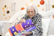 """Ruth Knelman, now 109, read """"The Owl and the Kitty Cat"""" to a group of preschoolers at Temple Israel last year."""